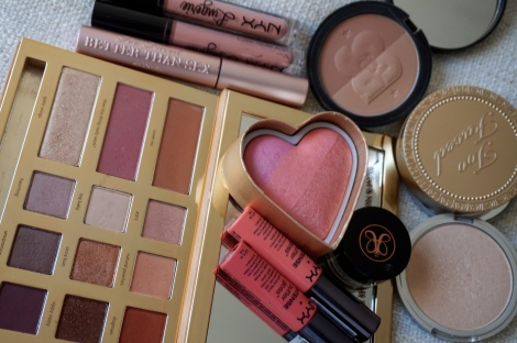 Swamp queen palette by Tarte, Too faced blush in candy glow, Too faced bronzer in sun bunny, mary-lou manager by the balm, Anastasia dip brow pomade in blonde, solar powder from soap and glory, nyx lingerie in baby doll, Nyx soft matte lip cream in ibiza, Nyx butter gloss in Napoleon, better than sex mascara by Too faced.